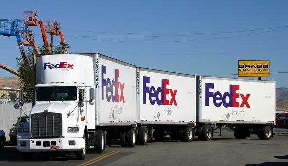 FedEx truck triples