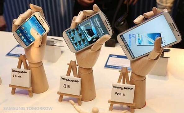 Galaxy devices in wooden hands