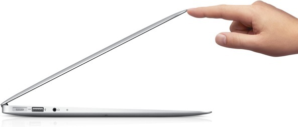 MacBook Air (lid half open, finger)