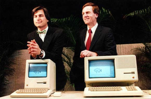 Steve Jobs and John Sculley pose with Macintosh