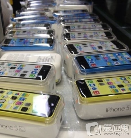 iPhone 5C packaged (blue, white, yellow)