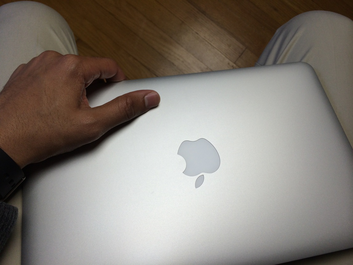 Holding MacBook Air