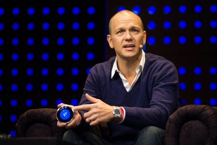 Tony Fadell holds Nest thermostat