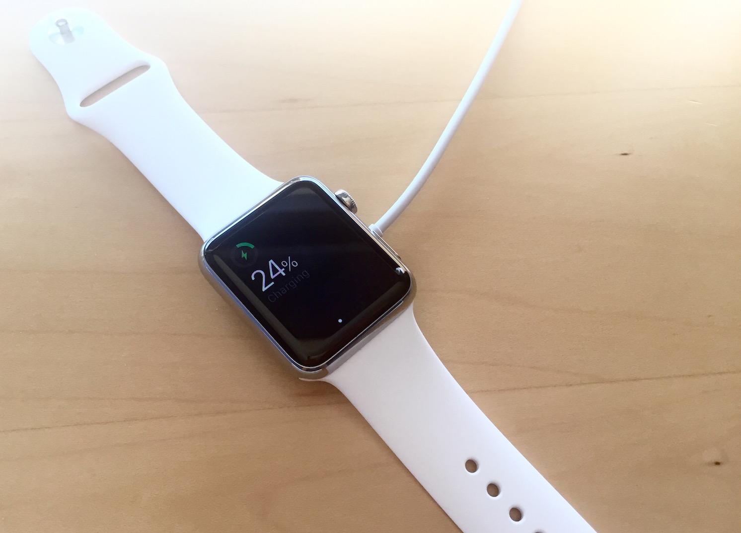 Apple Watch charging on desk