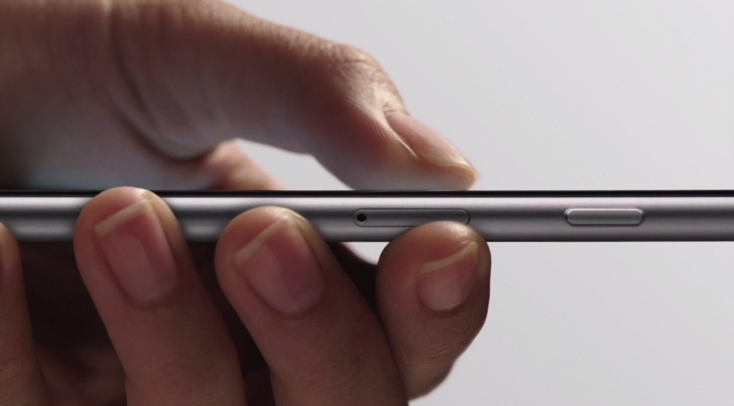iPhone 6s in hand, finger pressing the display with 3D Touch