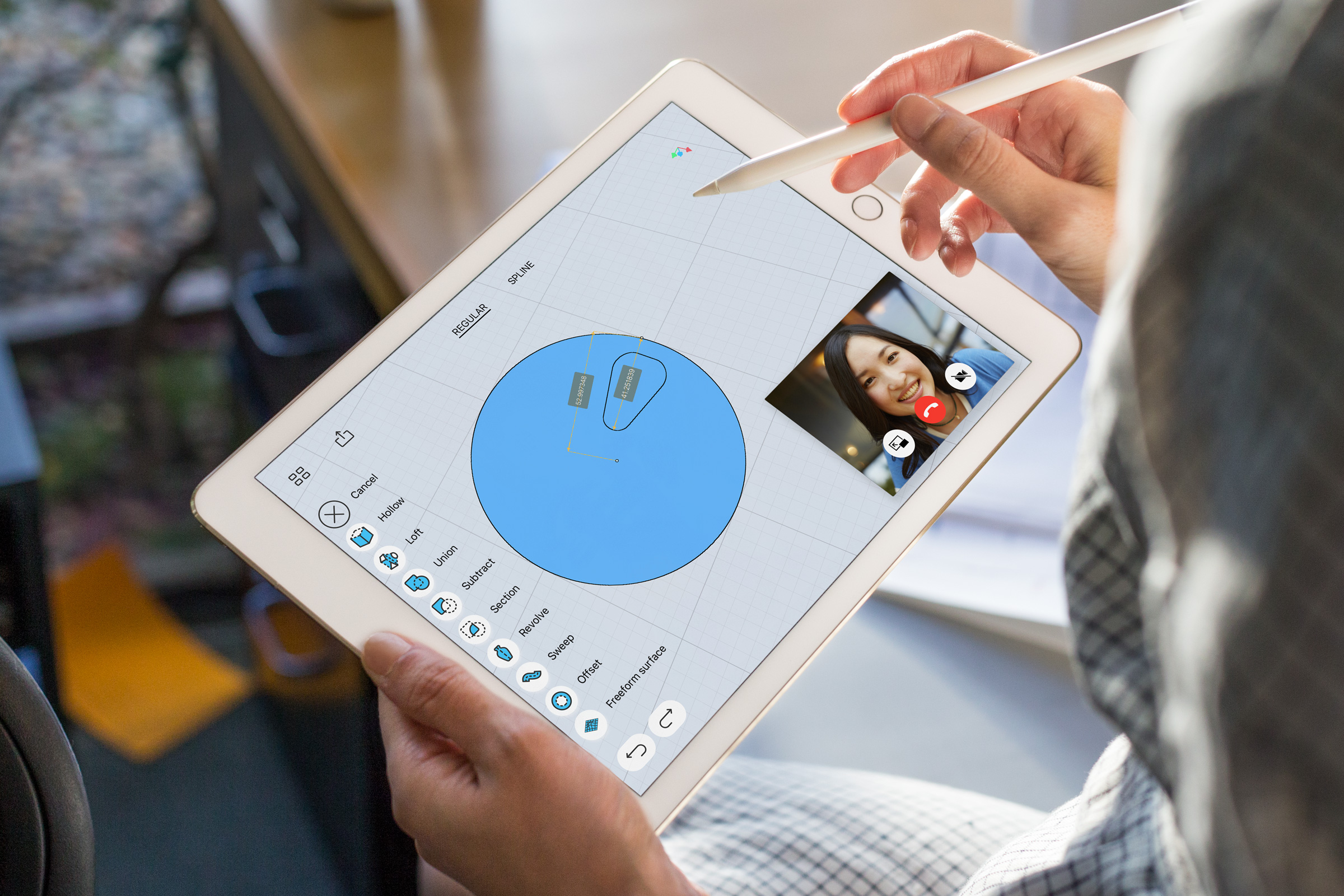 Promotional image showing a budget iPad held in one hand and Apple Pencil in another