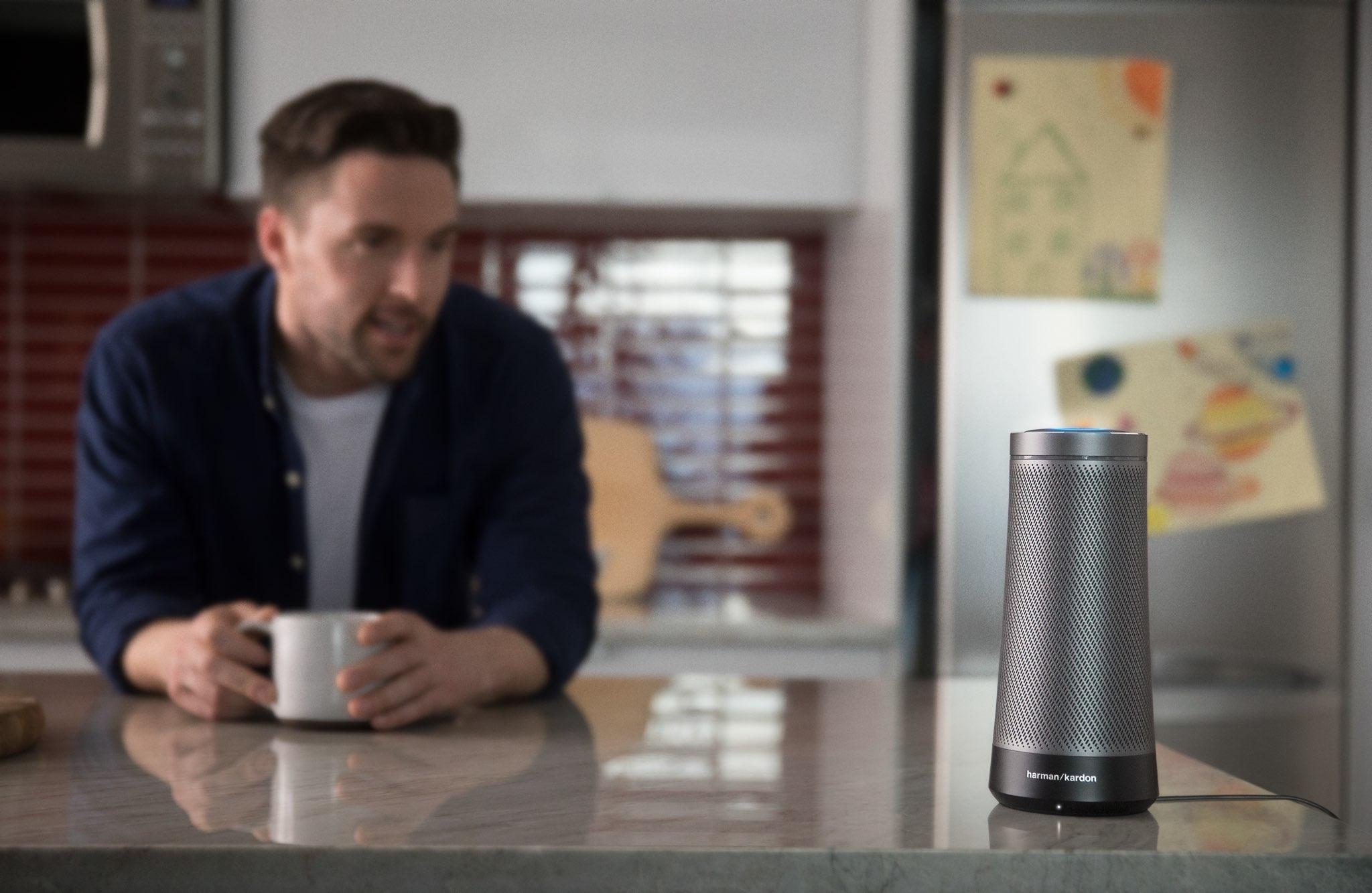 A lifestyle photograph promoting Harman Kardon's Invoke smart speaker featuring Microsoft's Cortana digital assistant