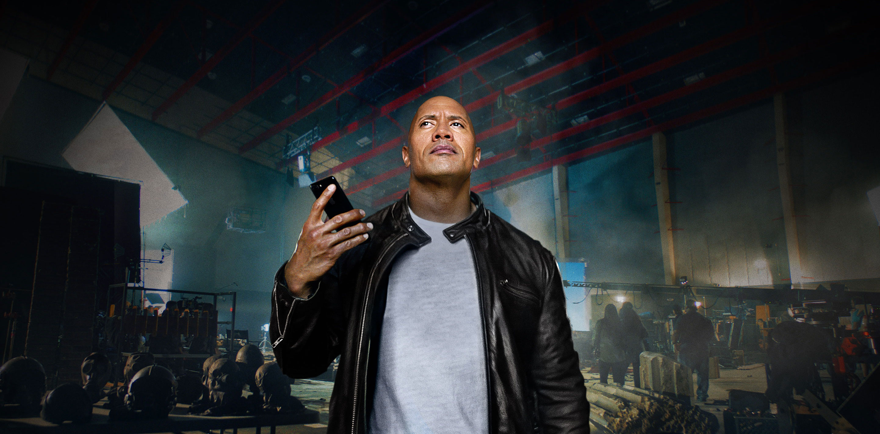 A screenshot from a TV spot featuring Dwayne Johnson aka The Rock using Siri to dominate his day