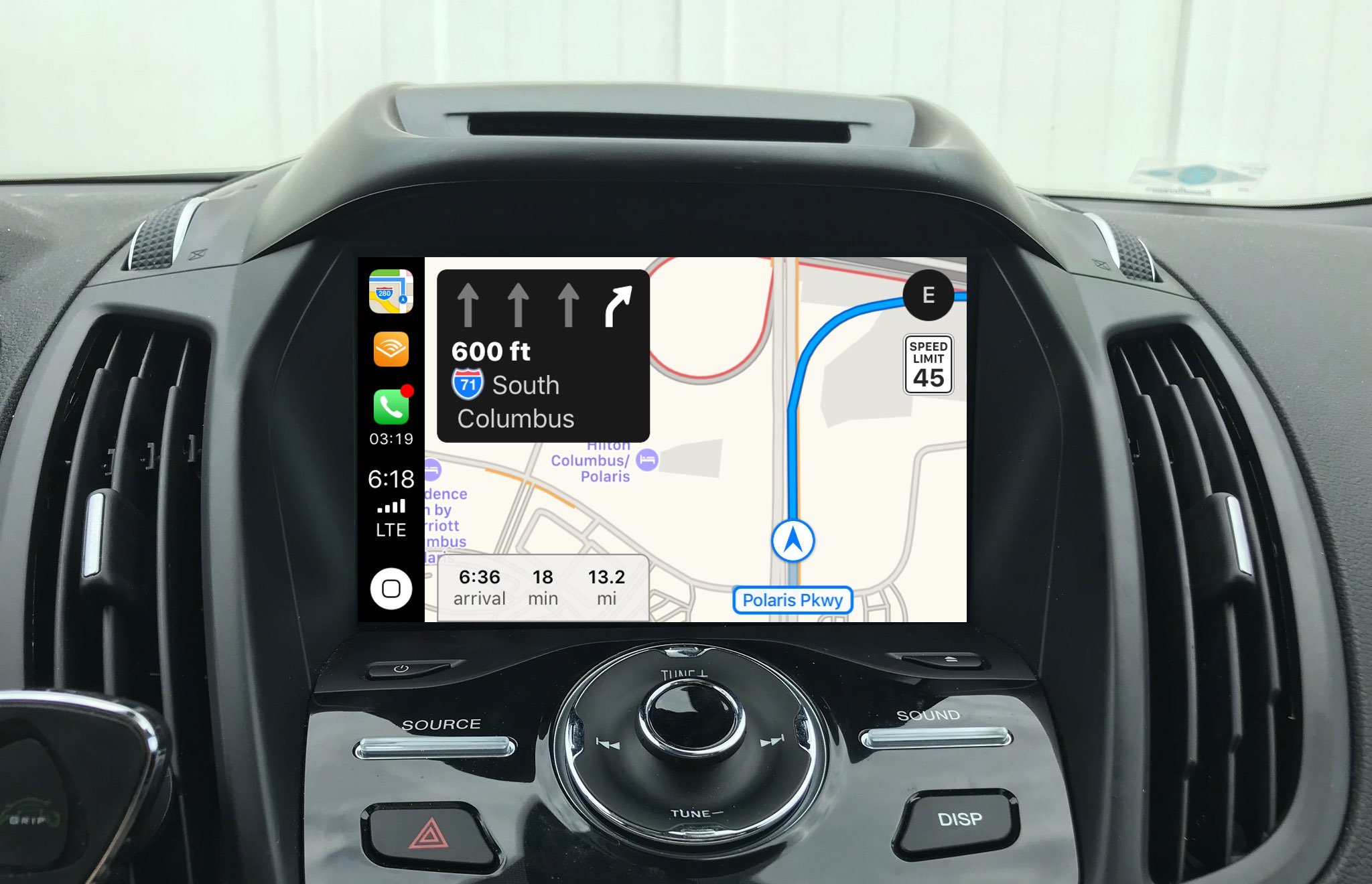 Apple Maps shown running on CarPlay with the lane guidance feature active