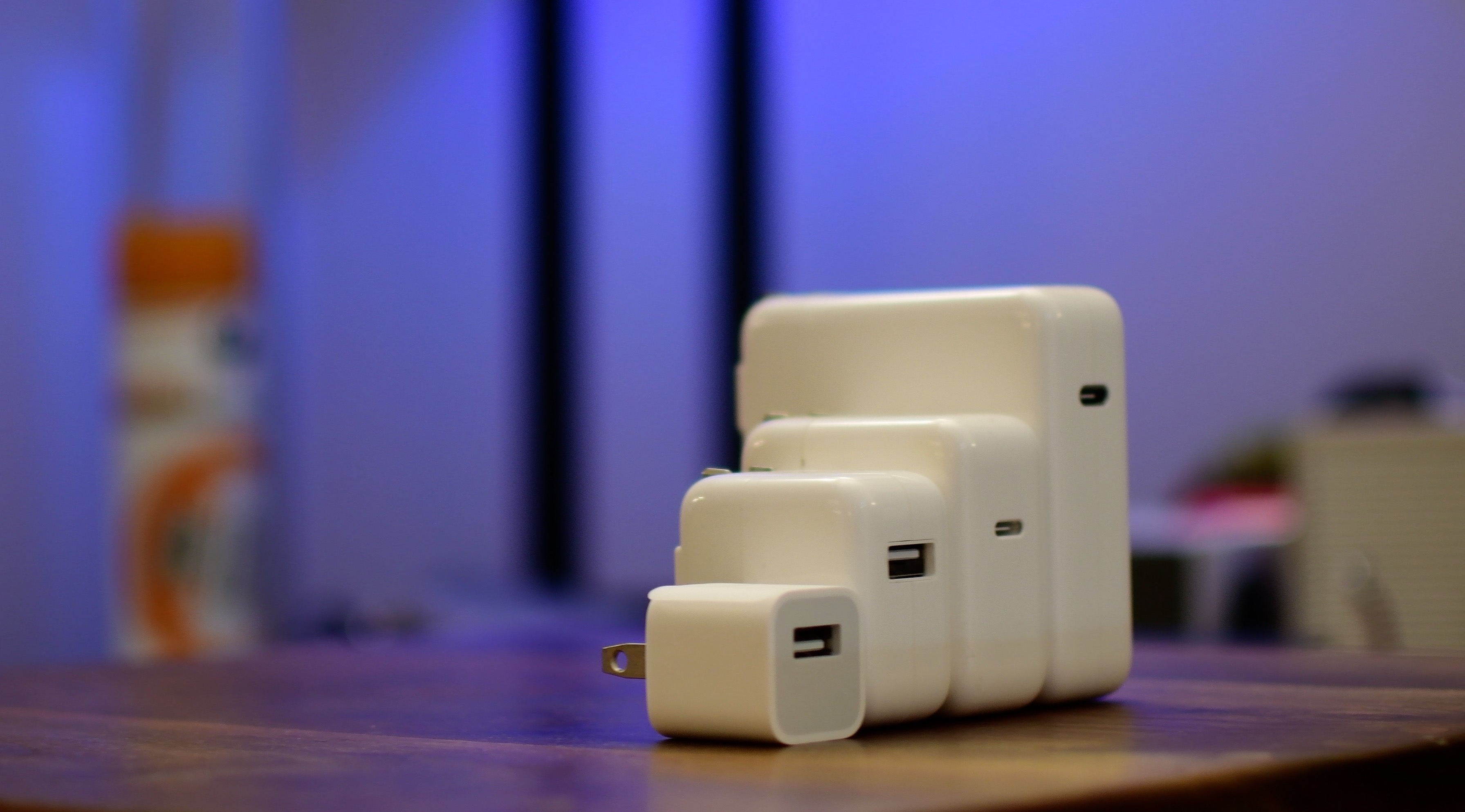 iPhone fast charge teaser image showing Apple USB power adapters and USB-C chargers