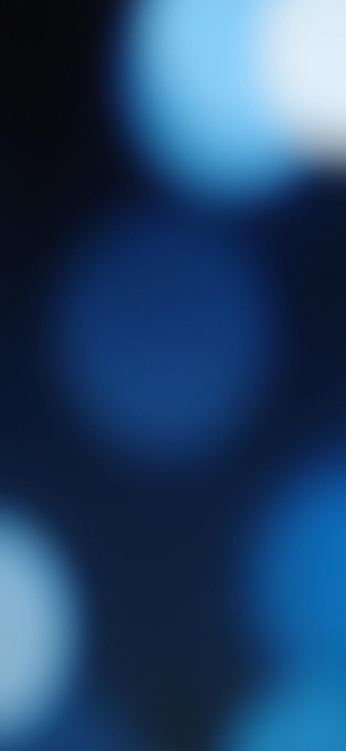 Blue spots on dark background