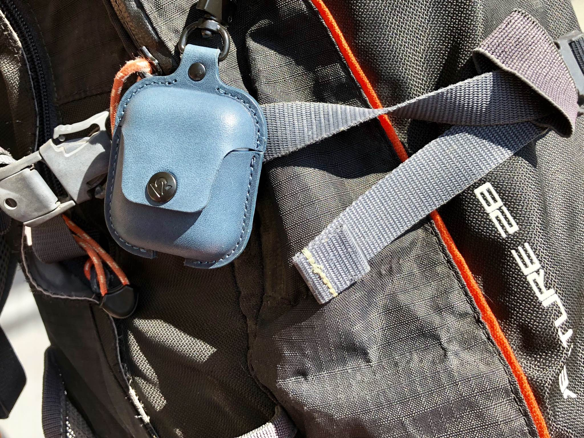 AirSnap hanging on a backpack
