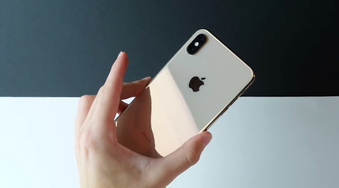 iPhone XS Max review - a photograph showing off the glass back of the phone along with the dual-camera system
