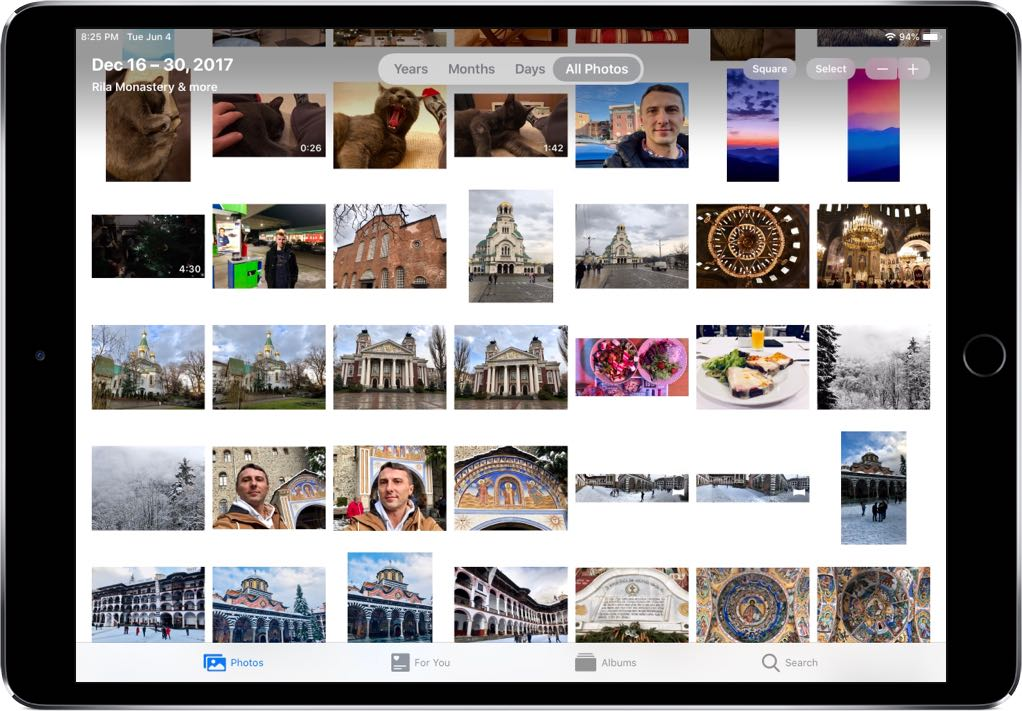 Browsing the library in the Photos app on iOS 13 with original aspect ratios
