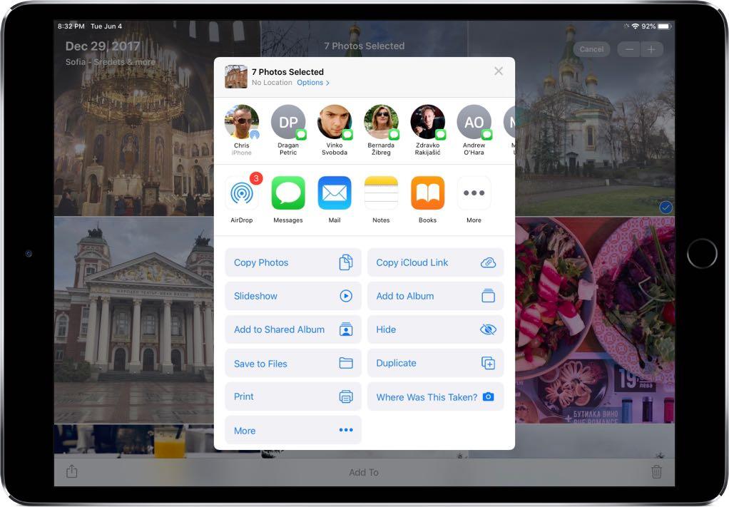 The Photos app includes iOS 13's redesigned Share menus.