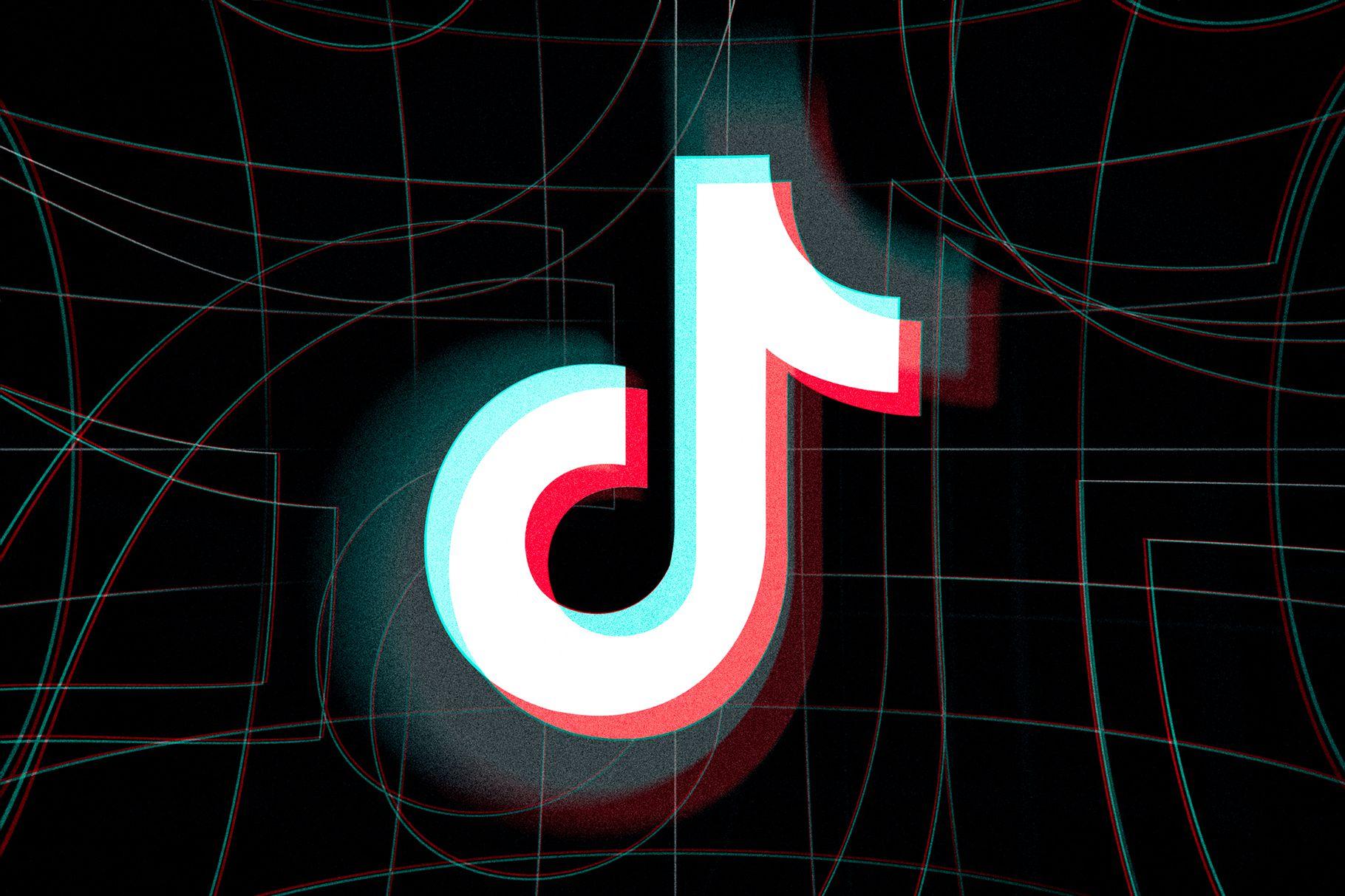 A TikTok logo set against a darkened background