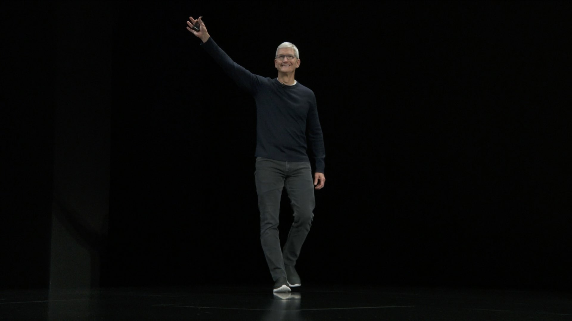 Tim Cook walking on stage and waiving crowds at an Apple product event