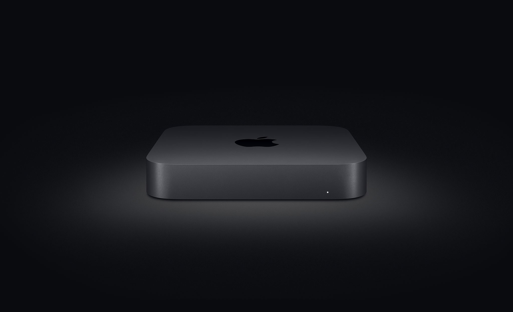 Apple's Mac mini computer photographed against a dark background