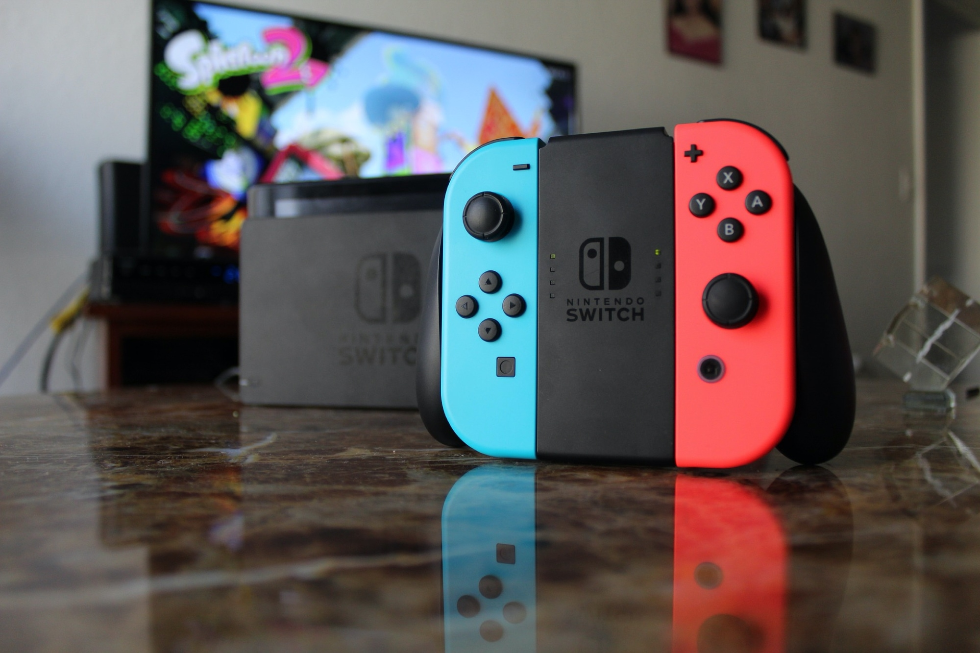 Nintendo Switch Joy Con Controllers in Grip - Pixabay
