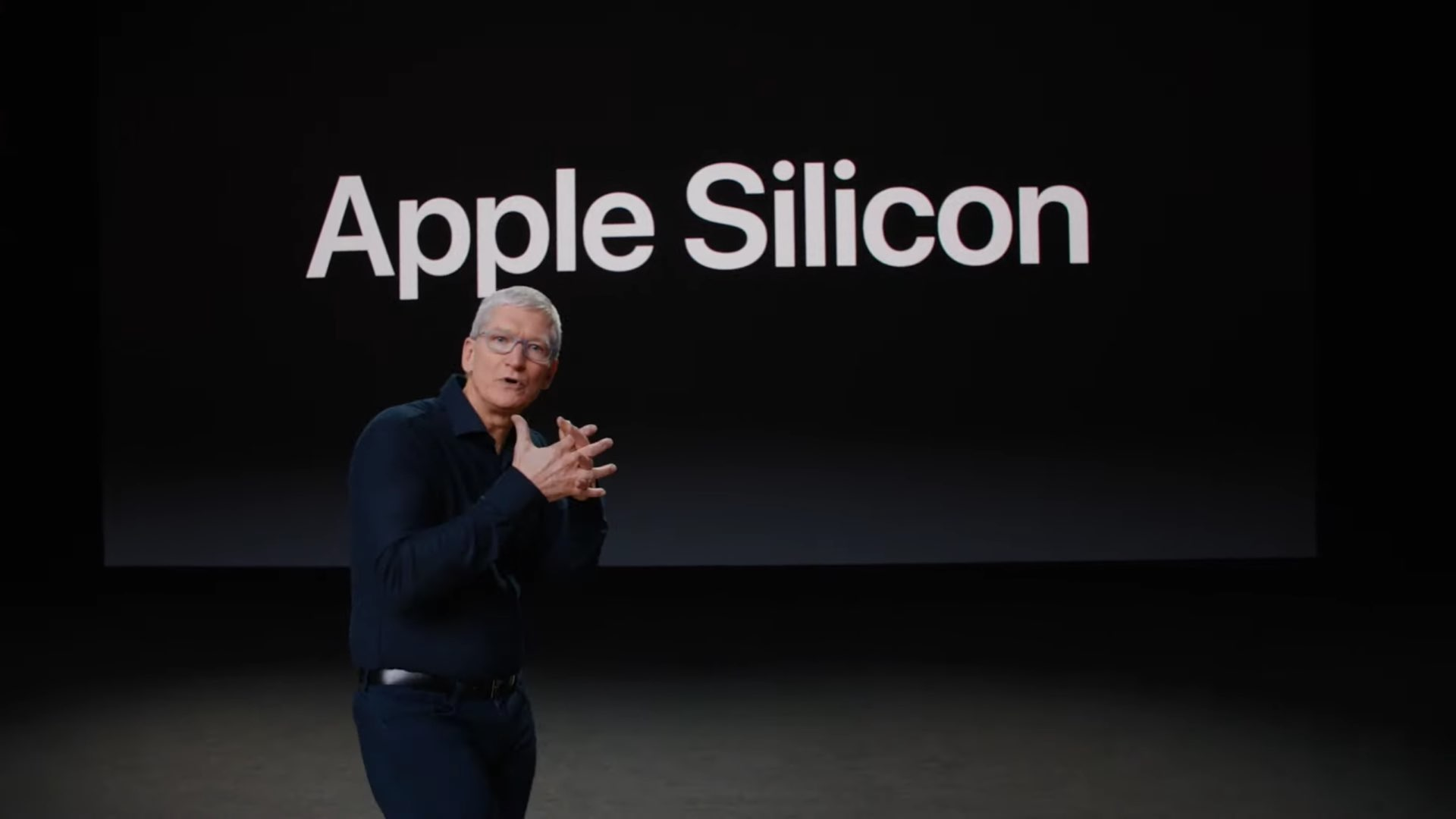 """A still from Apple WWDC20 video showing CEO Tim Cook in front of a slide showing the text """"Apple silicon"""""""