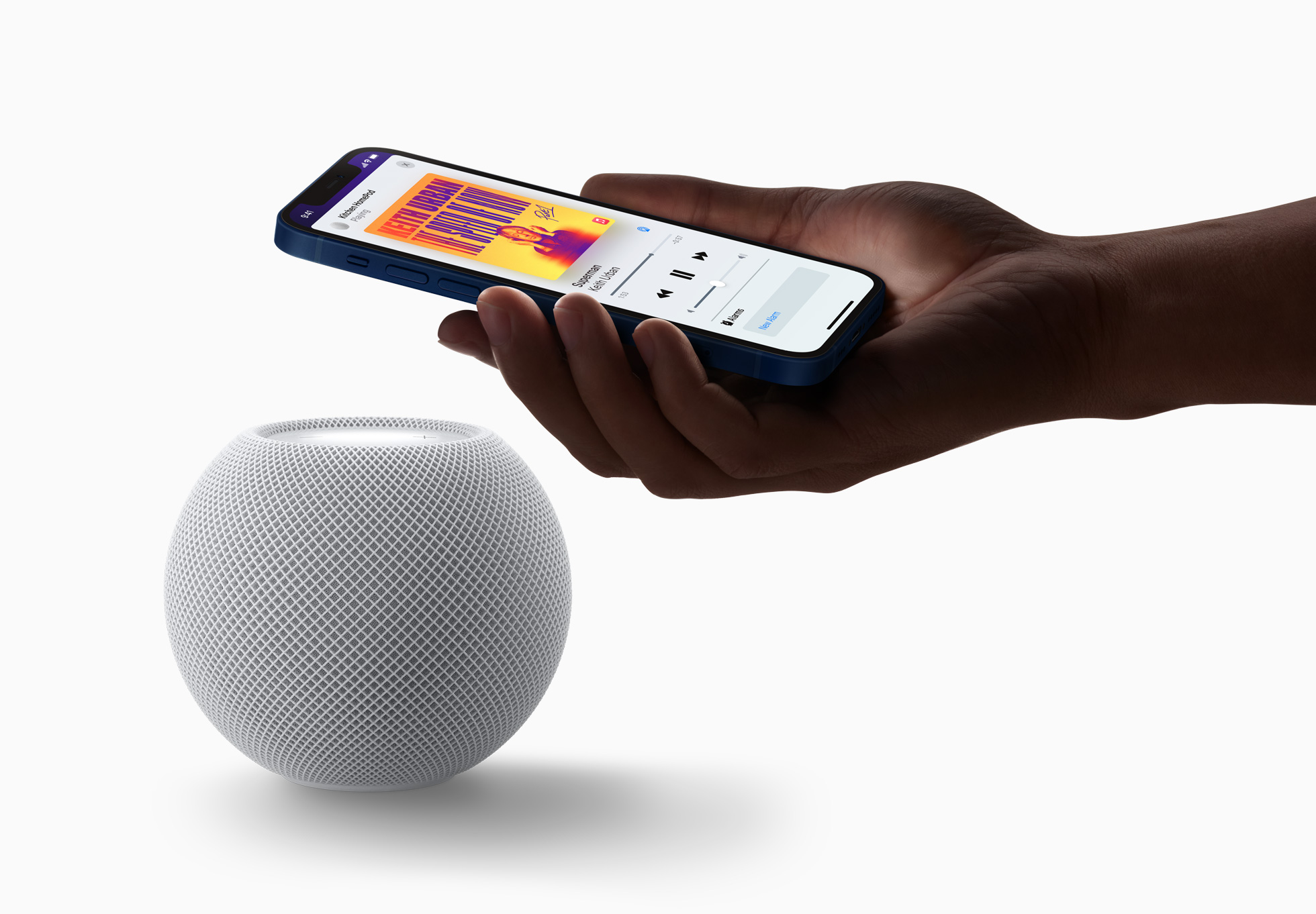 Apple TV surround sound - a HomePod mini shown playing music
