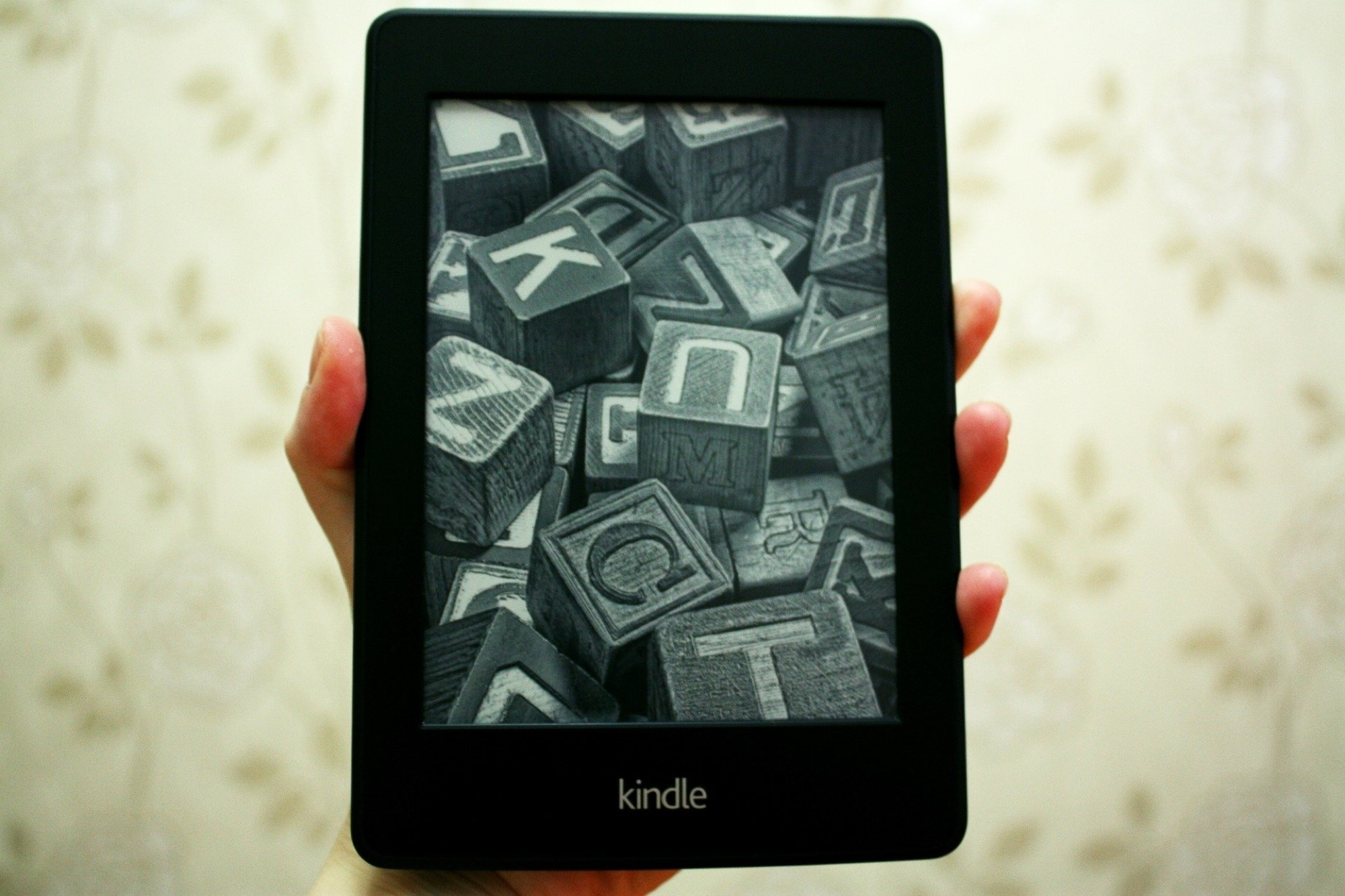 Holding a Kindle Paperwhite