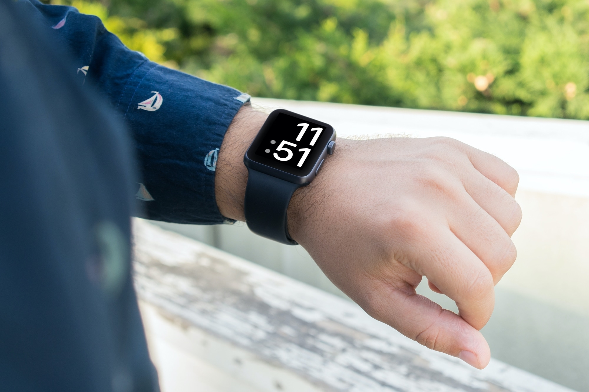 An Apple Watch Series 6 with the X-Large watch face shown on the display
