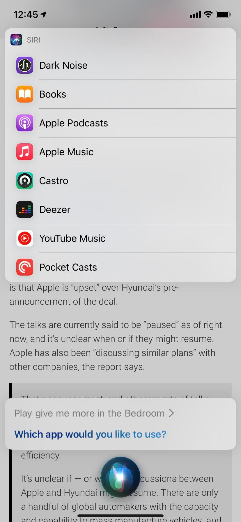 A screenshot of the Siri interface in iOS 14.5 asking the user to pick the default app for music streaming
