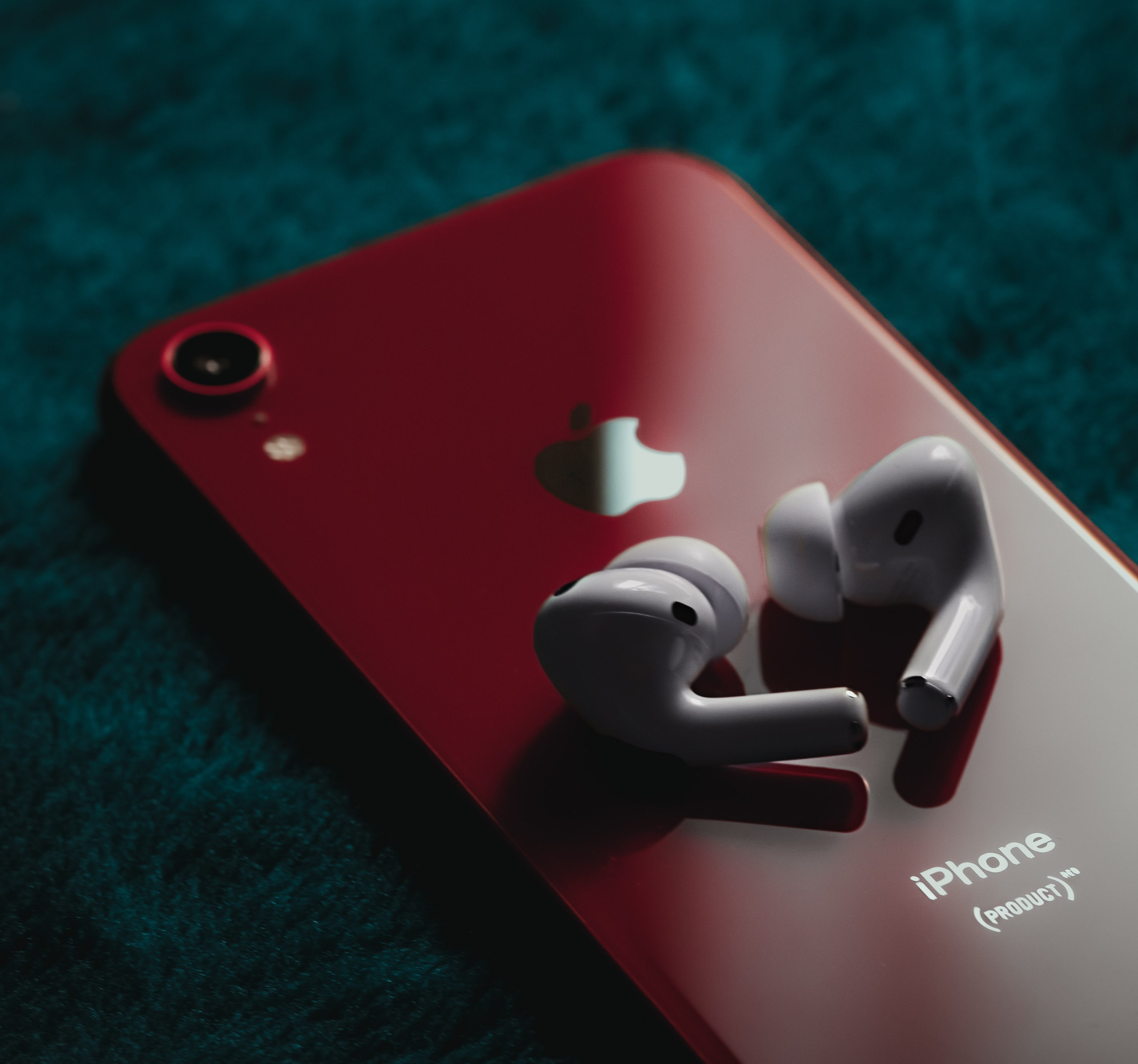 iPhone Product Red back AirPods white