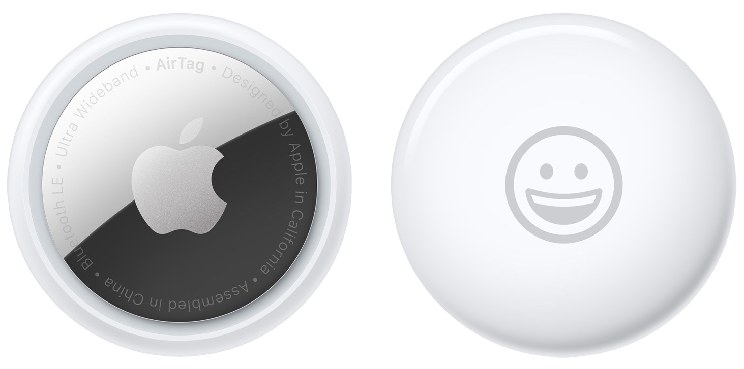 A promotional image from Apple showing the back and front of the AirTag personal item tracker with a smiley emoji engraved