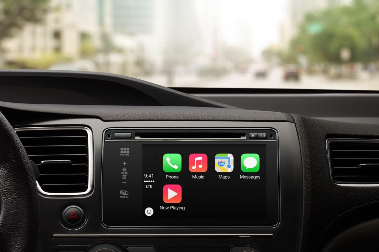 Apple's marketing image showing a car interior with the CarPlay dashboard