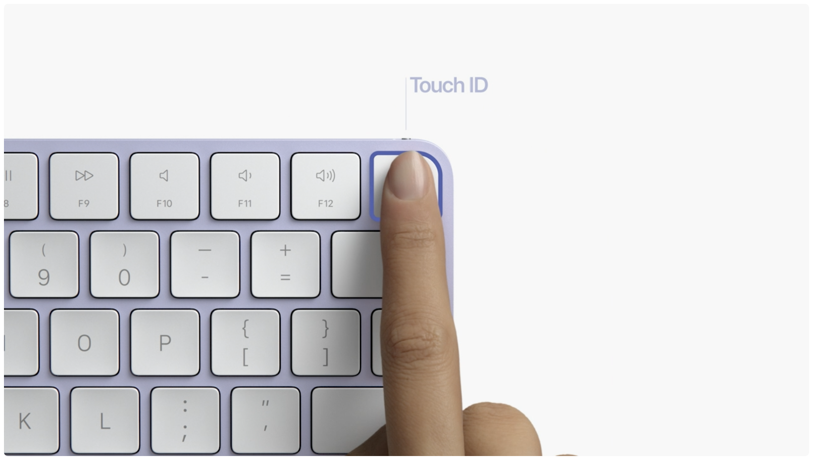 Apple's promotional graphic showing the iMac's new Magic Keyboard in purple with a female index finger resting on Touch ID