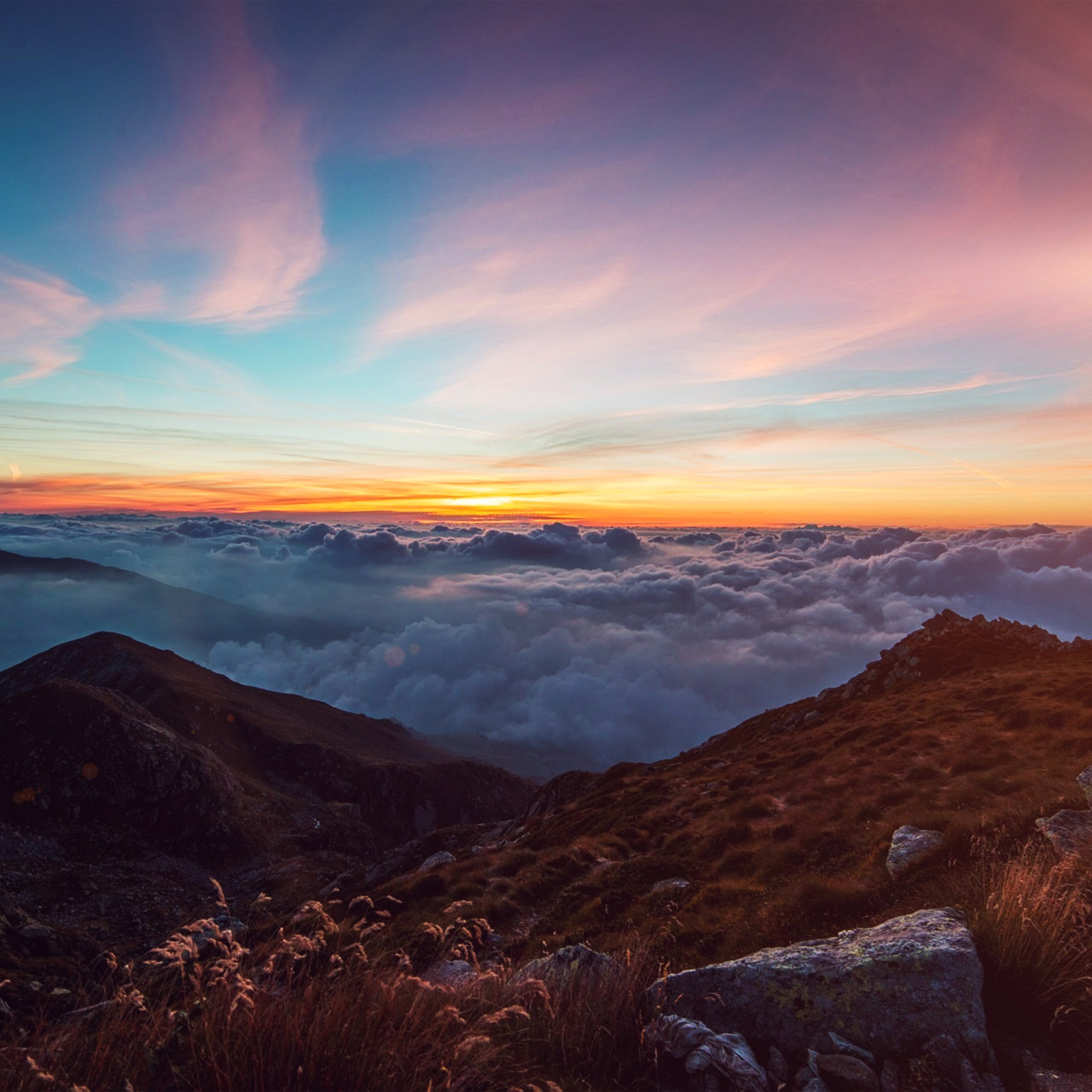 Sunrise wallpaper for iPhone idownloadblog clouds mountains