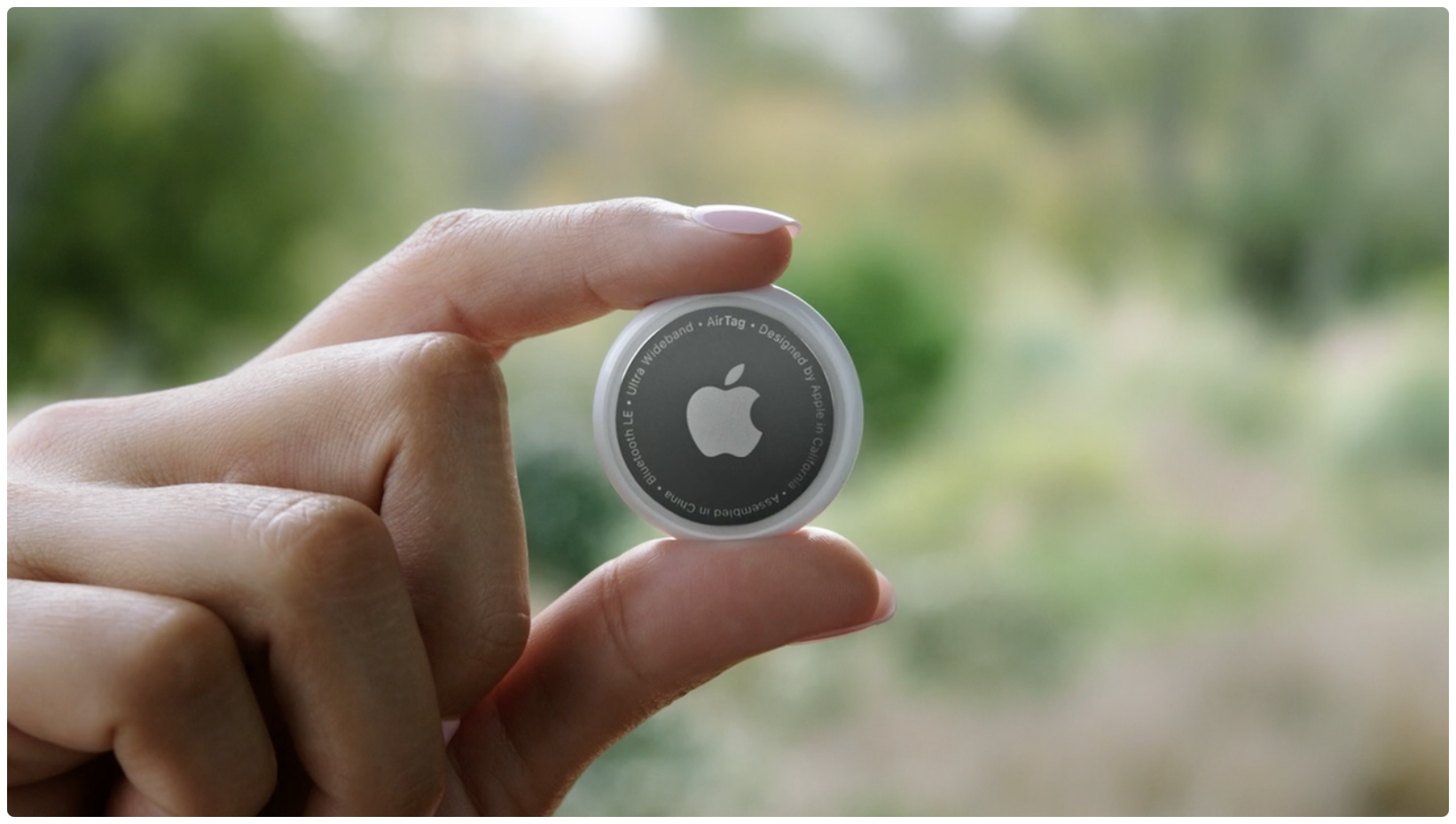 Apple's promotional image for the AirTag personal item tracker