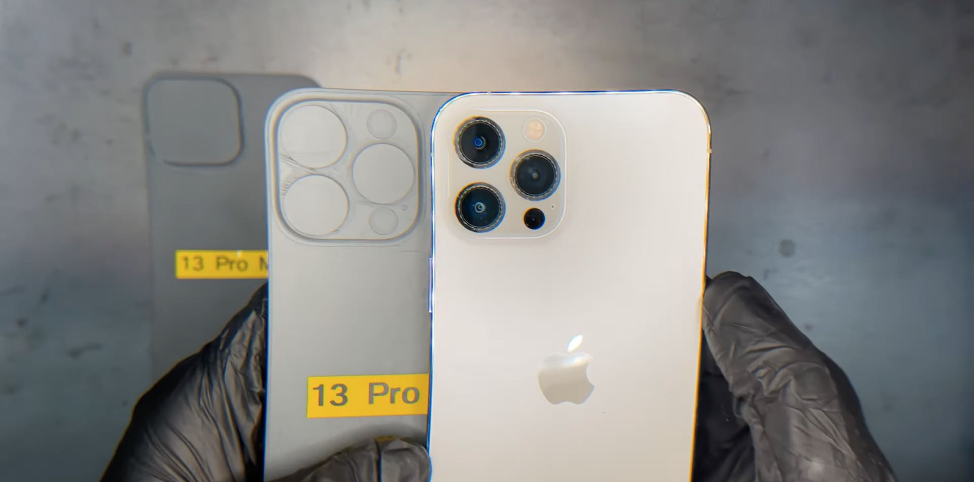 A still from EverythingApplePro's video showing significantly larger lenses on a 3D-printed iPhone 13 Pro Max mockup
