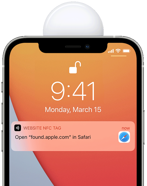 An image showing the white side of an Apple AirTag held to the top of an iPhone 12 with Safari's Found notification displayed on the screen