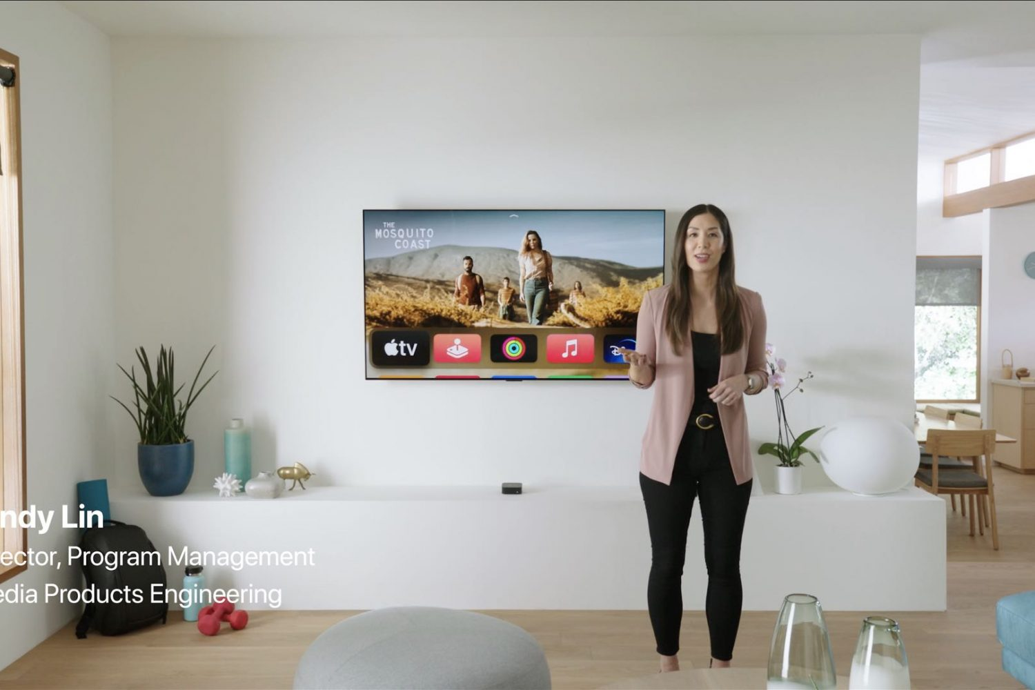 A still image from the April 2021 Apple event video in which executive Cindy Lin discusses the Apple TV 4K while standing in front of a TV in a living room set