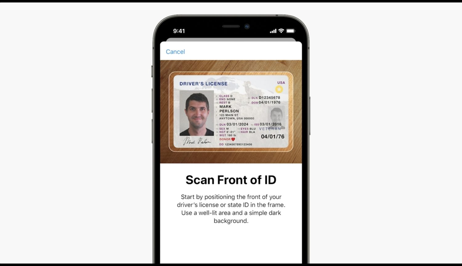 Apple's promotional image for iOS 15 showing an iPhone with a user's driver's license in the Wallet app