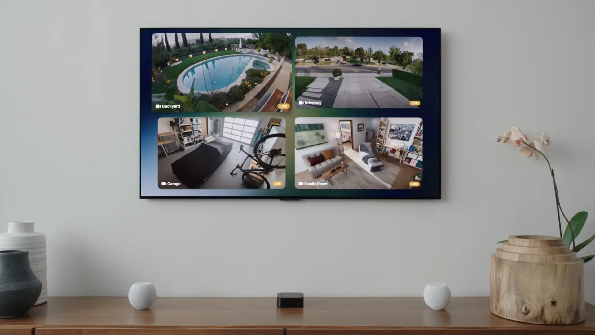 An image showing four simultaneous video feeds from HomeKit security cameras displayed in a 2x2 grid on Apple TV with tvOS 15