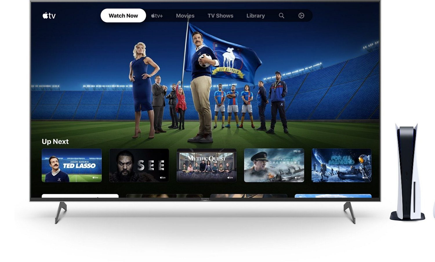Promotional image showing a large TV set with the Applet TV app on the Ted Lasso page and a Sony PlayStation 5 console next to it