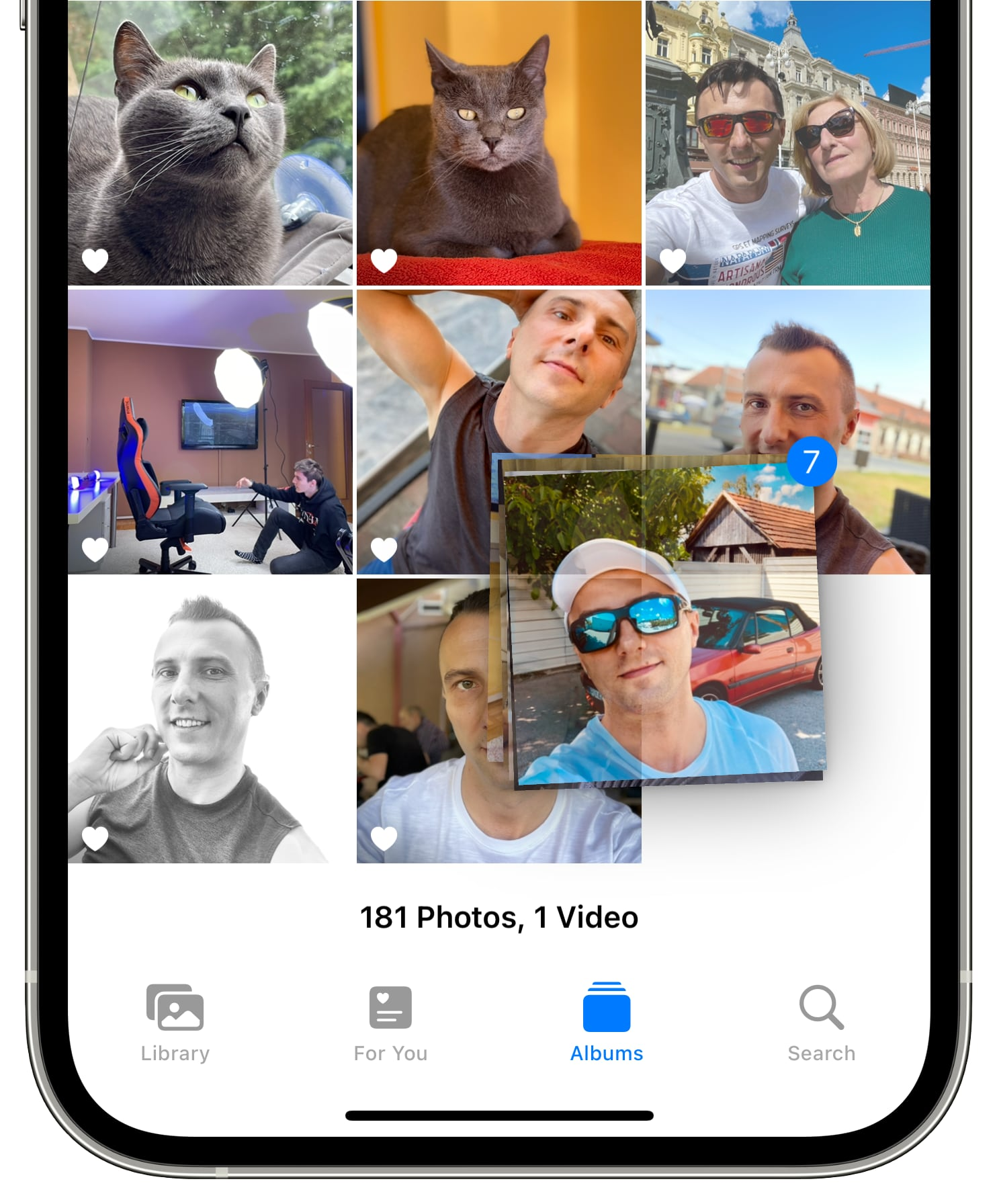 An iPhone screenshot showing creating a bundle of images for drag and drop in the Photos app on iOS 15