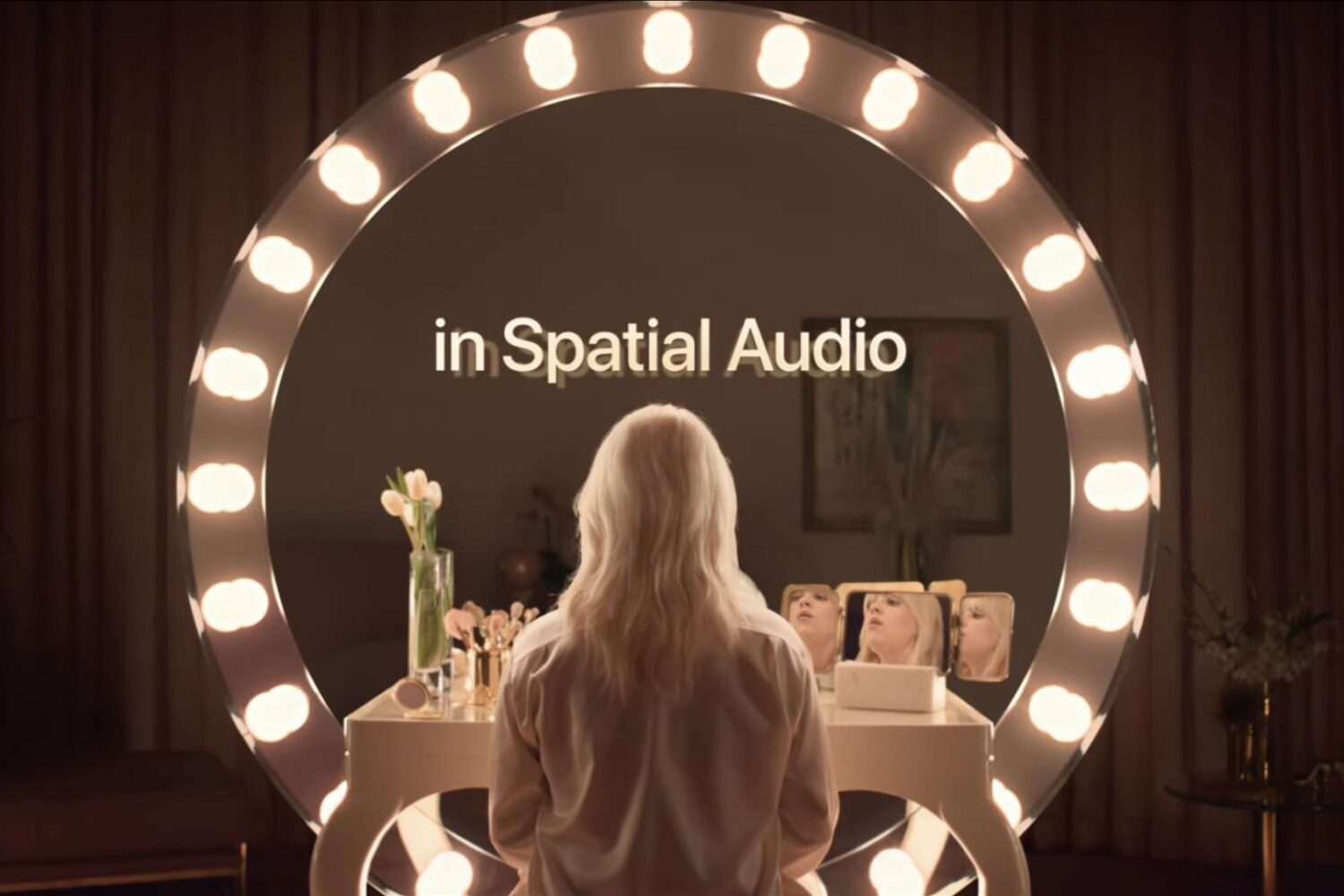 A still from Apple Music ad with Billie Eilish promoting spatial audio