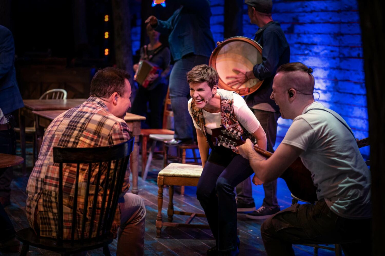 """A still photograph of a scene form Apple TV+ Hollywood musical """"Come From Away"""""""