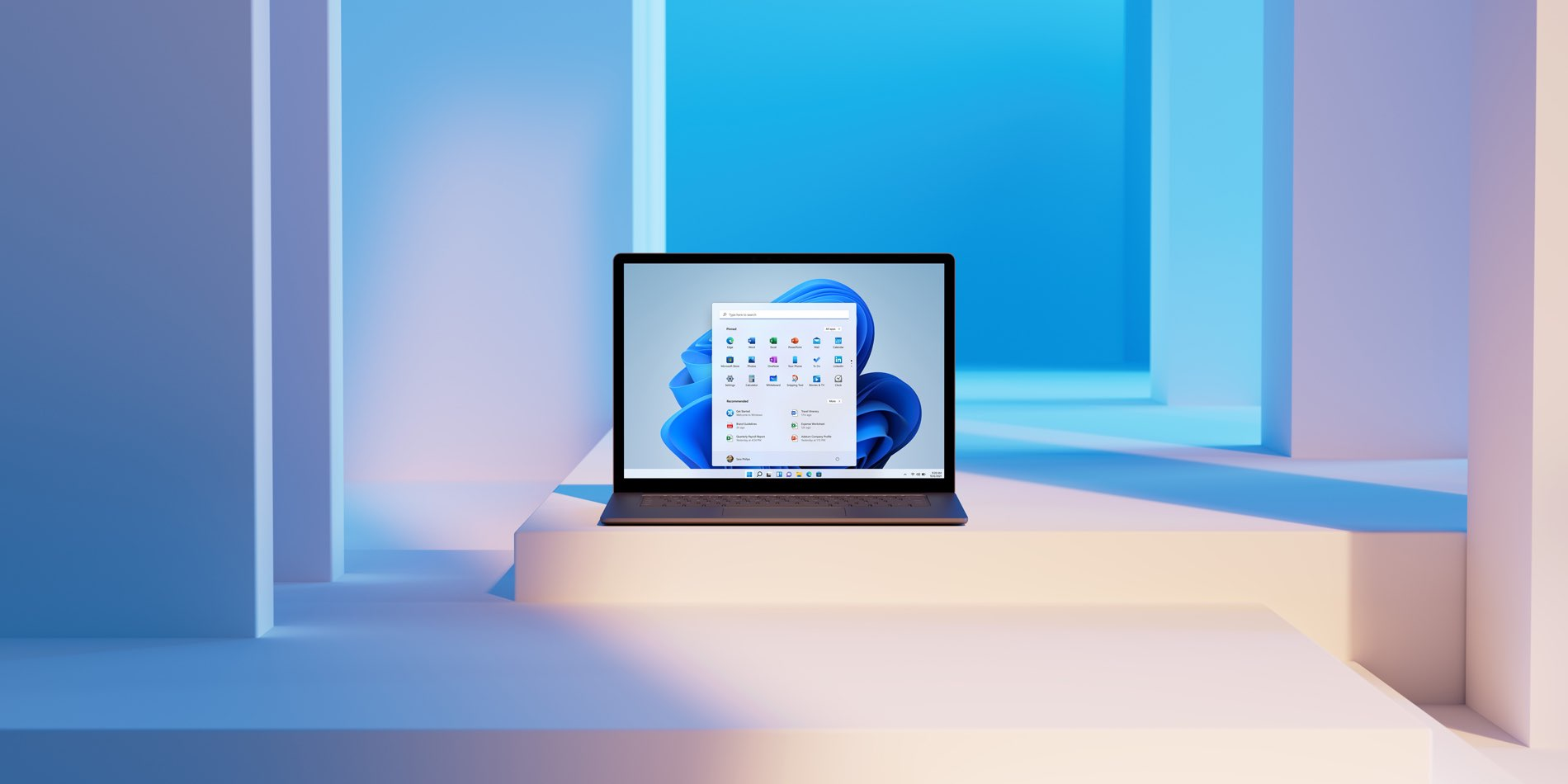 A Microsoft promotional image showing a Windows 11 PC with the centered Start menu