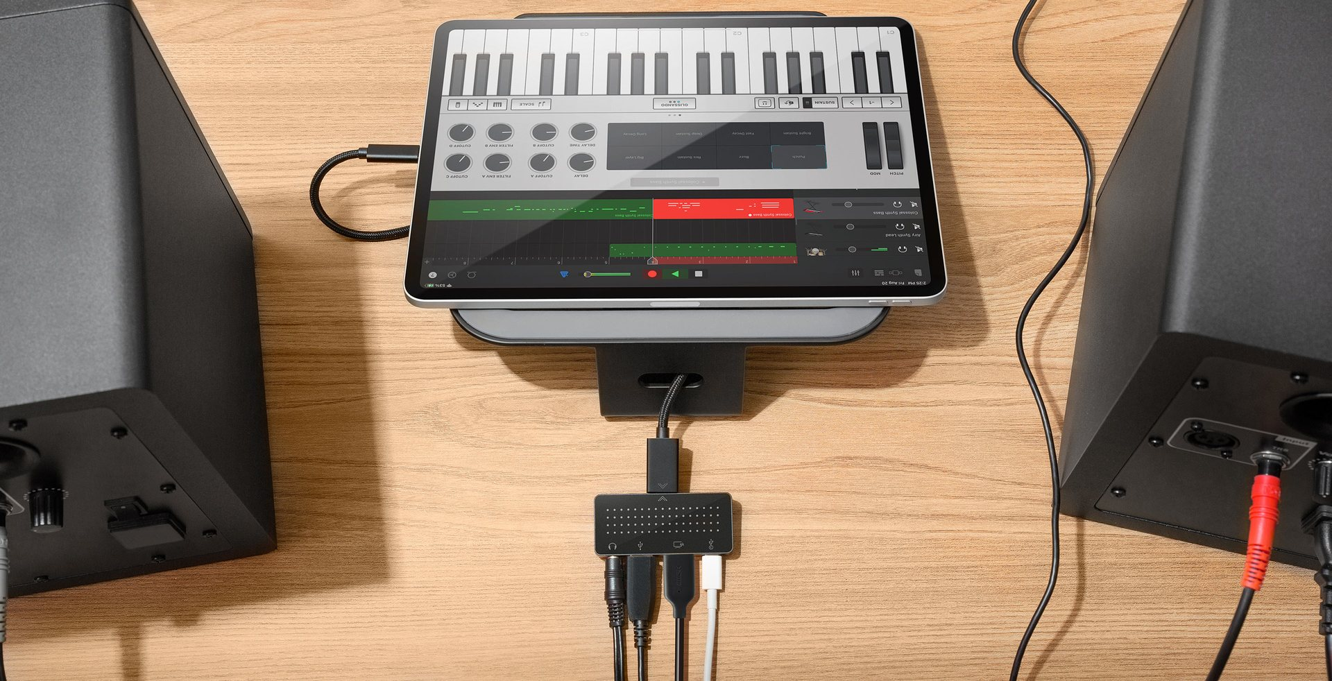 A promotional image from Twelve South showing its StayGo Mini USB-C hub connected to a MacBook Pro