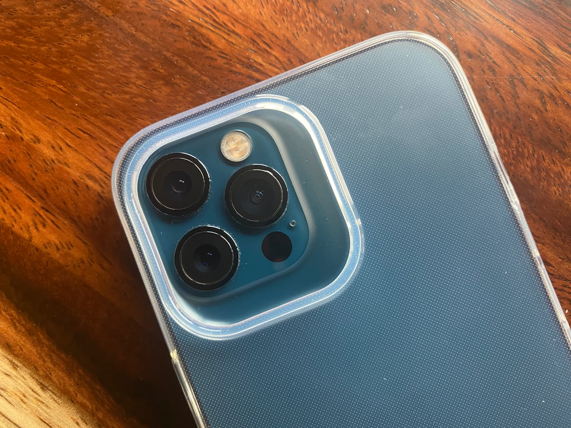 An image showing a massive rear camera bump cutout on a minimalist iPhone 13 case from Totallee