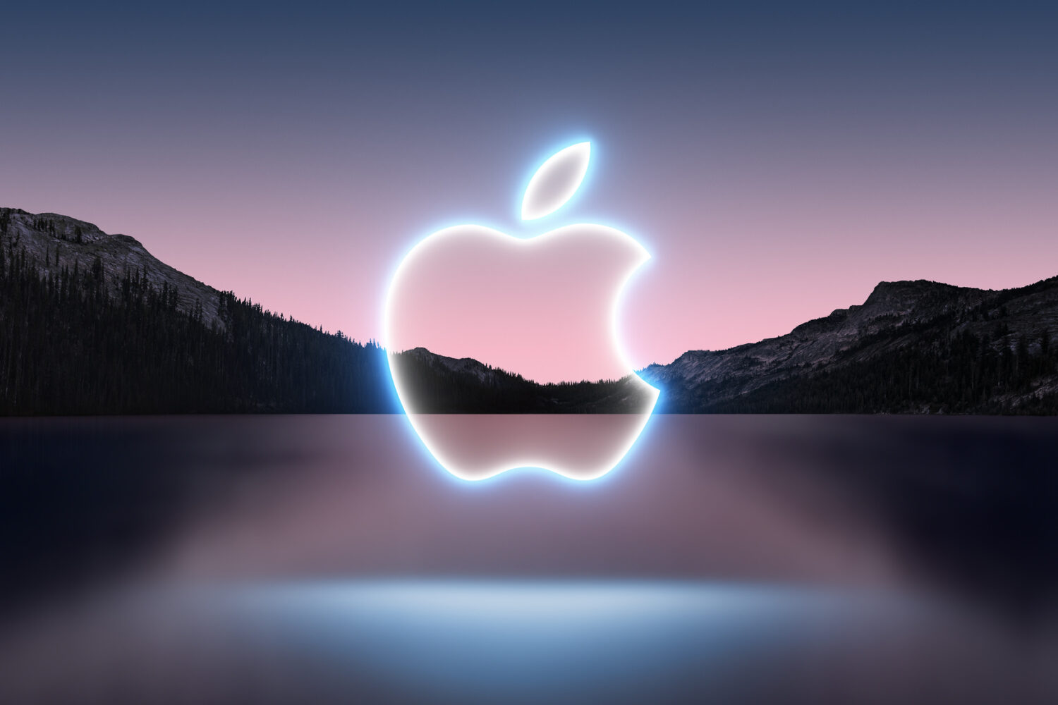 Promotional illustration for the September 14 iPhone 13 event showing a glowing Apple logo outline set against lake scenery shot in the dusk