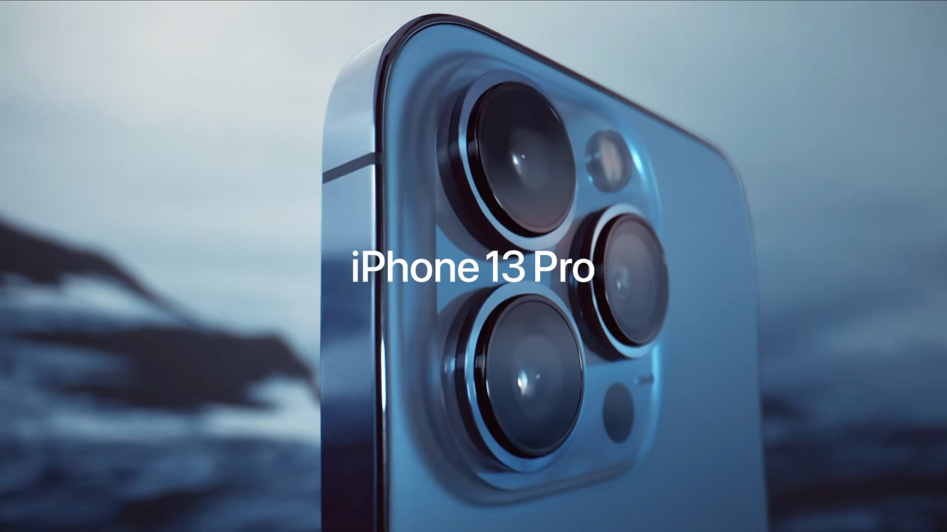 A still image taken from Apple's iPhone 13 Pro introduction video on YouTube, showing a closeup of the three cameras on the back.