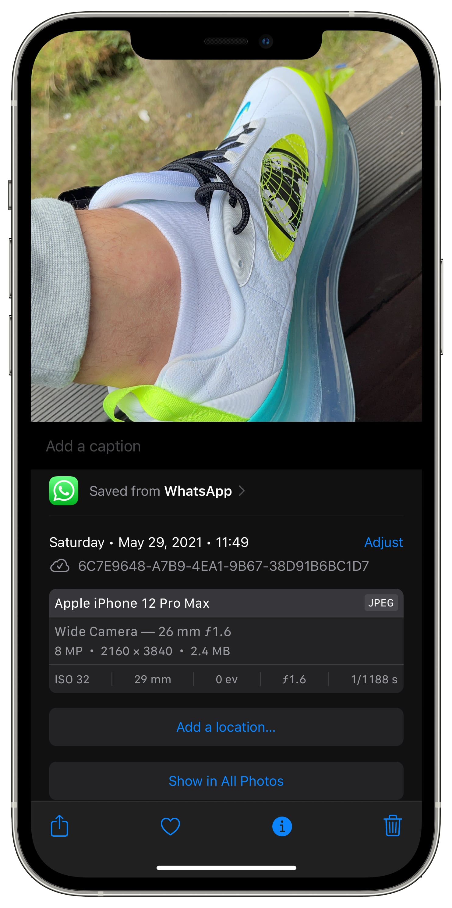 """iPhone screenshot showing the image information screen with the """"Saved from"""" section in iOS 15 Photos"""